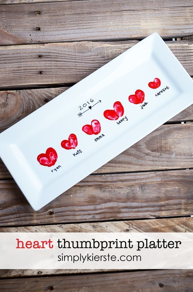 Add your children's fingerprints in the shape of heart onto a white serving plat...