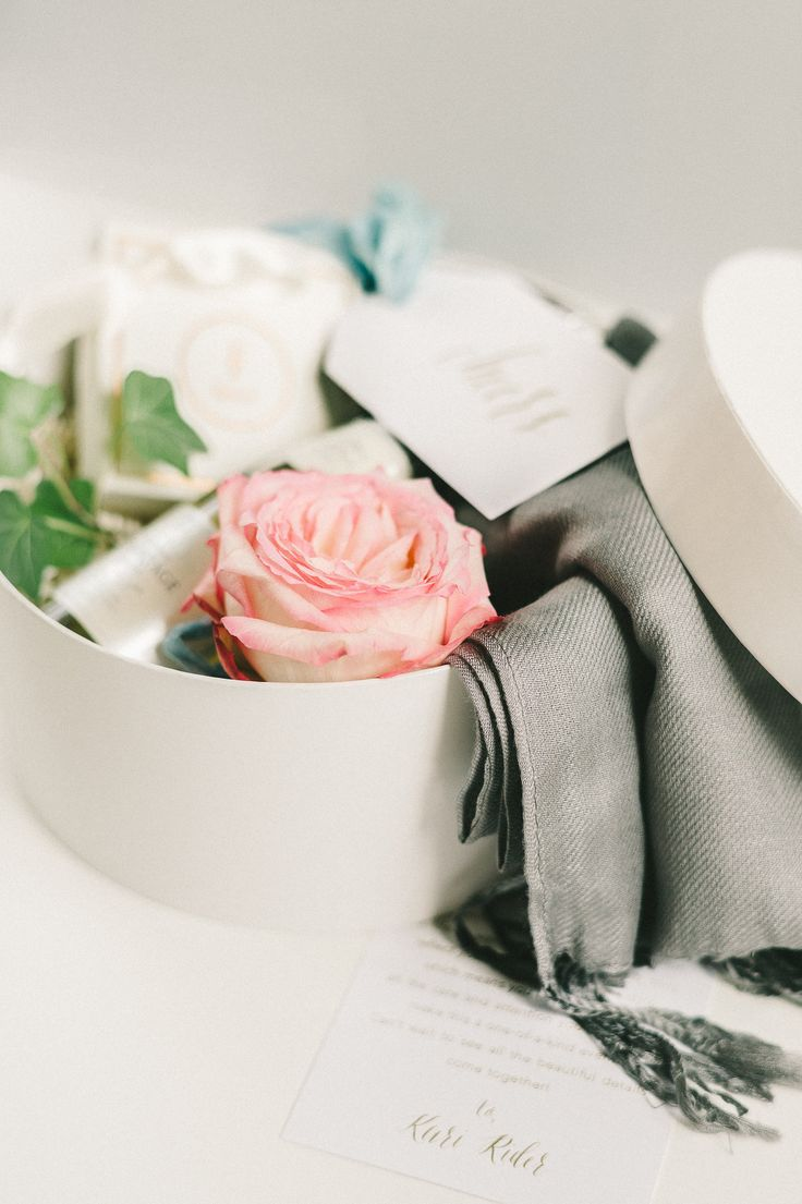 Marigold & Grey creates custom welcome gifts with a simple and elegant touch tha...