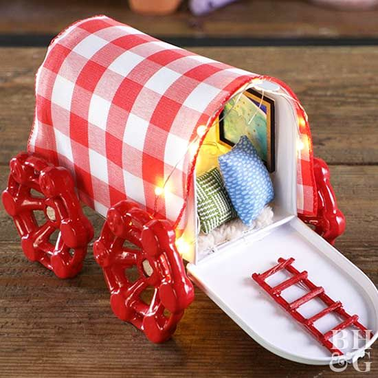 Dollhouse pillows line the inside of the wagon to comfort your fairy friends.