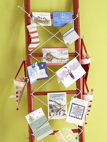 Make pretty holiday cards part of your decor by displaying them on a painted lad...