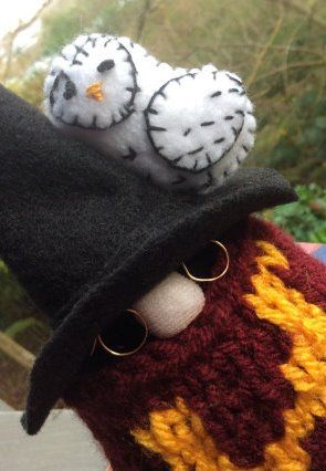 How adorable! Harry Potter themed knitted gnome with a sweart and a felt Hedwig....