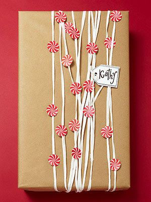 For a fresh take on gift wrapping, stock up on cheap Kraft paper and gorgeous tr...