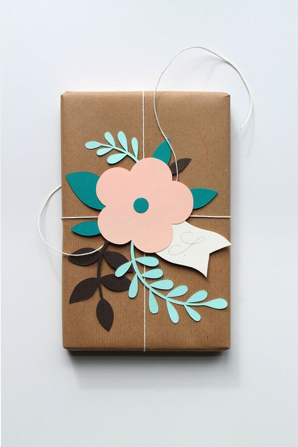 Floral wrapping idea : a small brad either enamelled with colour or not, would g...