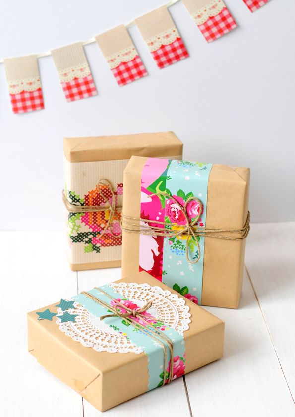 Pretty gift wrap idea for dressing up brown paper with doily, twine and colourfu...