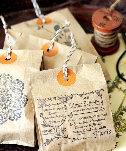 Great packaging idea! Print any image or words onto a paper bag. Punch a hole. A...