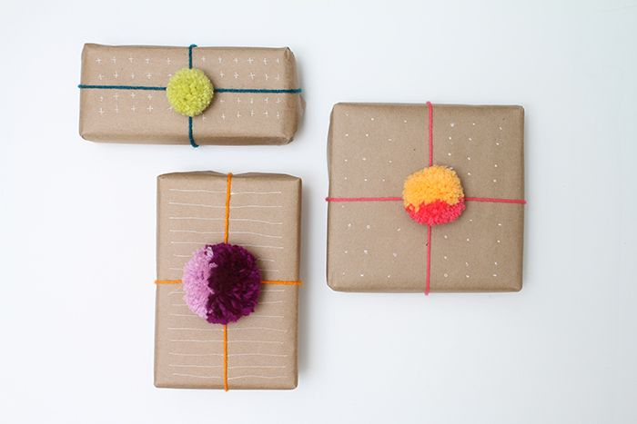 Use yarn pom-poms as a more playful way to top a gift than a classic ribbon.