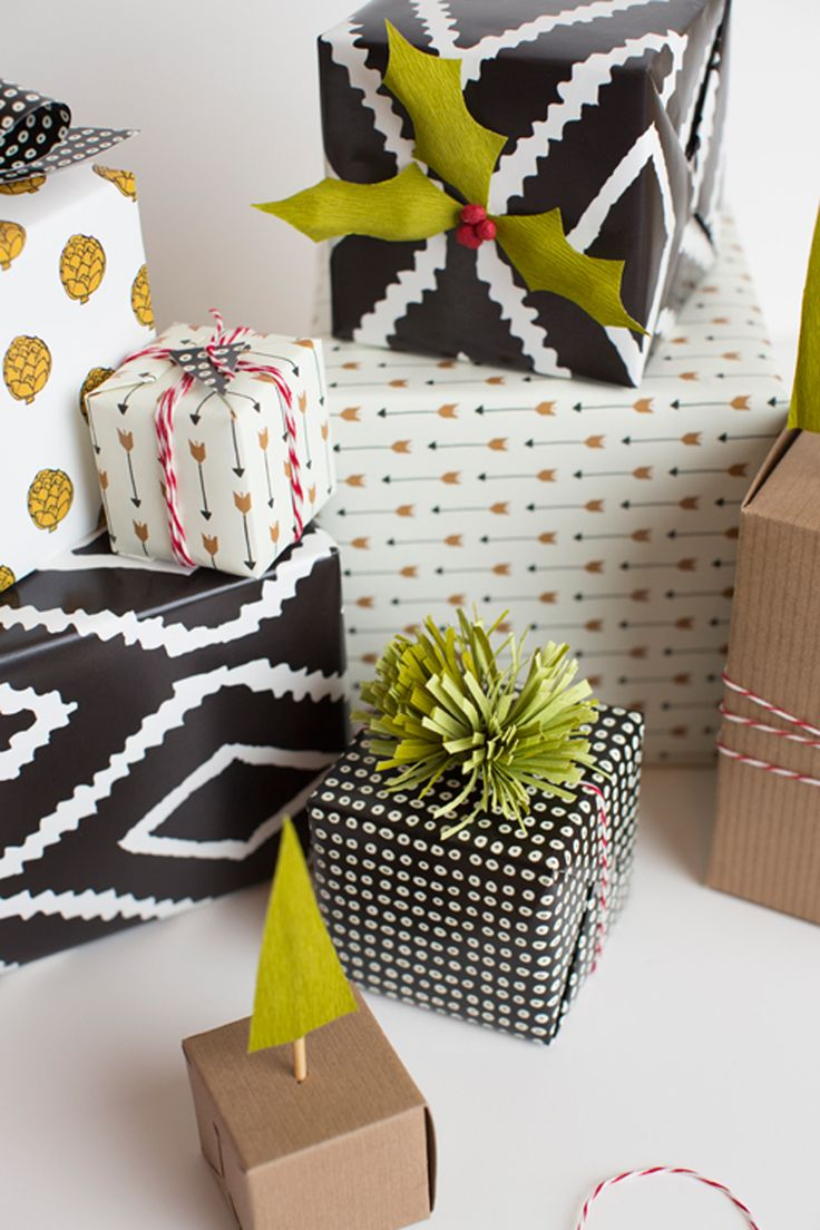 Using a graphic wrapping paper gives a fun and modern touch. Add a pom pom toppe...