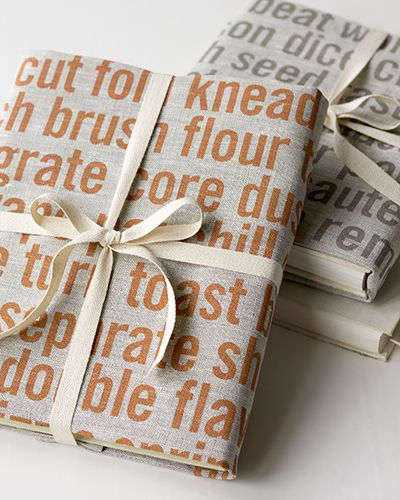 Wrap a cookbook with tea towels from Studiopatró. 2 gifts-in-1.
