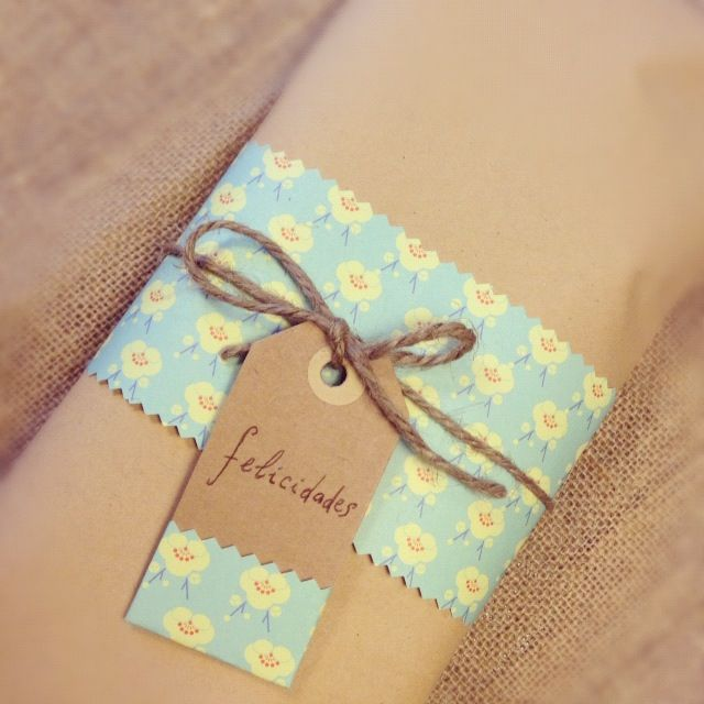 Wrap a gift with kraft paper, decorate with a scrap of patterned paper with a ma...