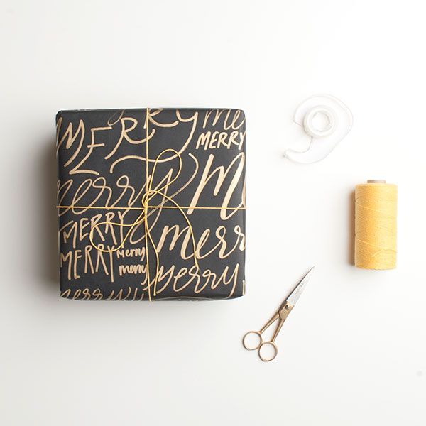 GORGEOUS hand drawn wrapping paper tutorial. I love the gold pen on the black pa...