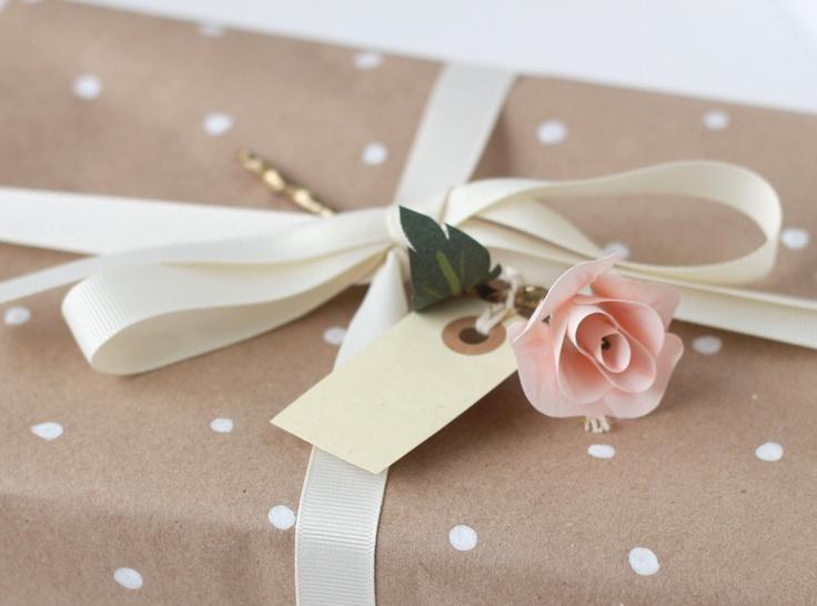 Lovely paper rose gift topper.