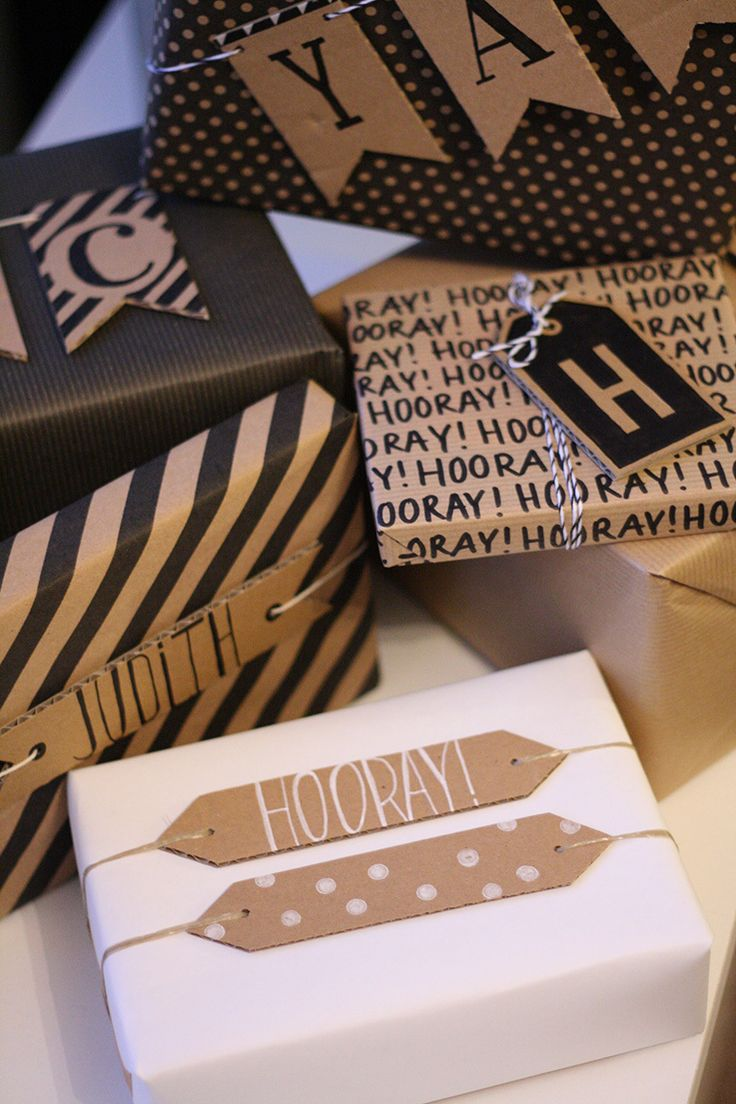 gift wrapping with cardboard banners and tags