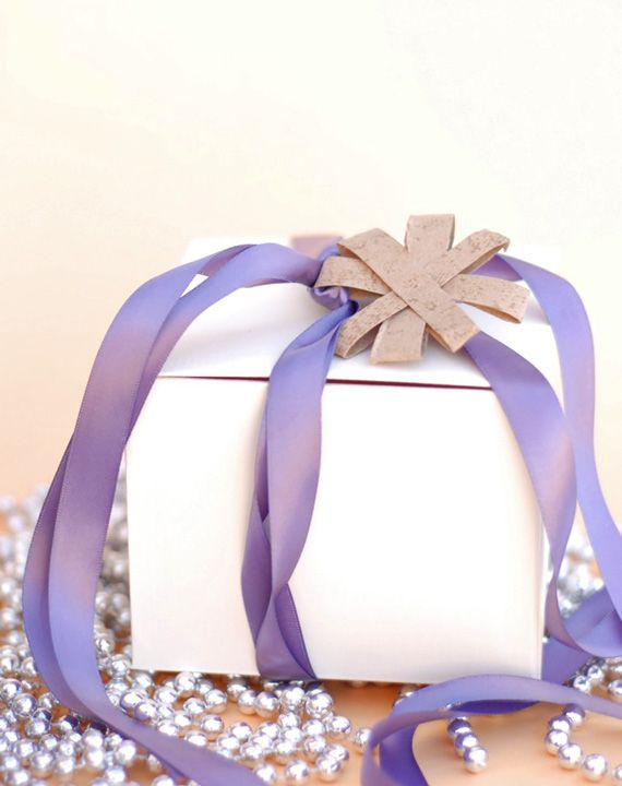 Simple star gift toppers from toilet paper rolls.