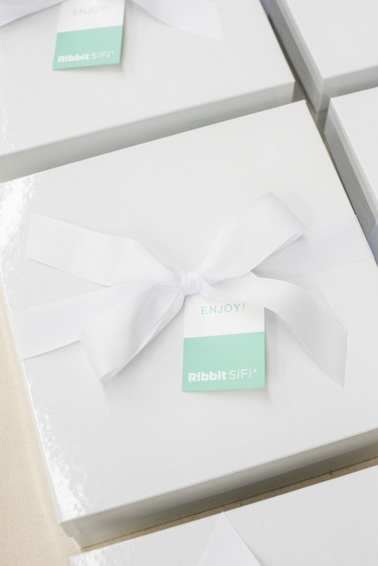 CORPORATE EVENT GIFTS// White and pastel company gift boxes are custom designed ...