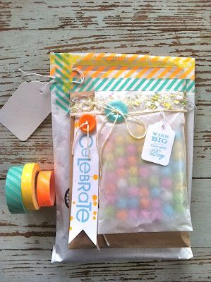 layered glassine bags with washi tape, buttons, twine - love!!