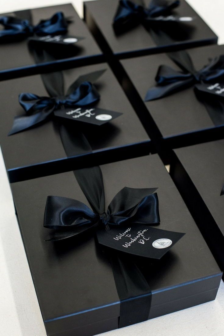 CORPORATE EVENT GIFT BOXES// Black and white DC themed company conference welcom...