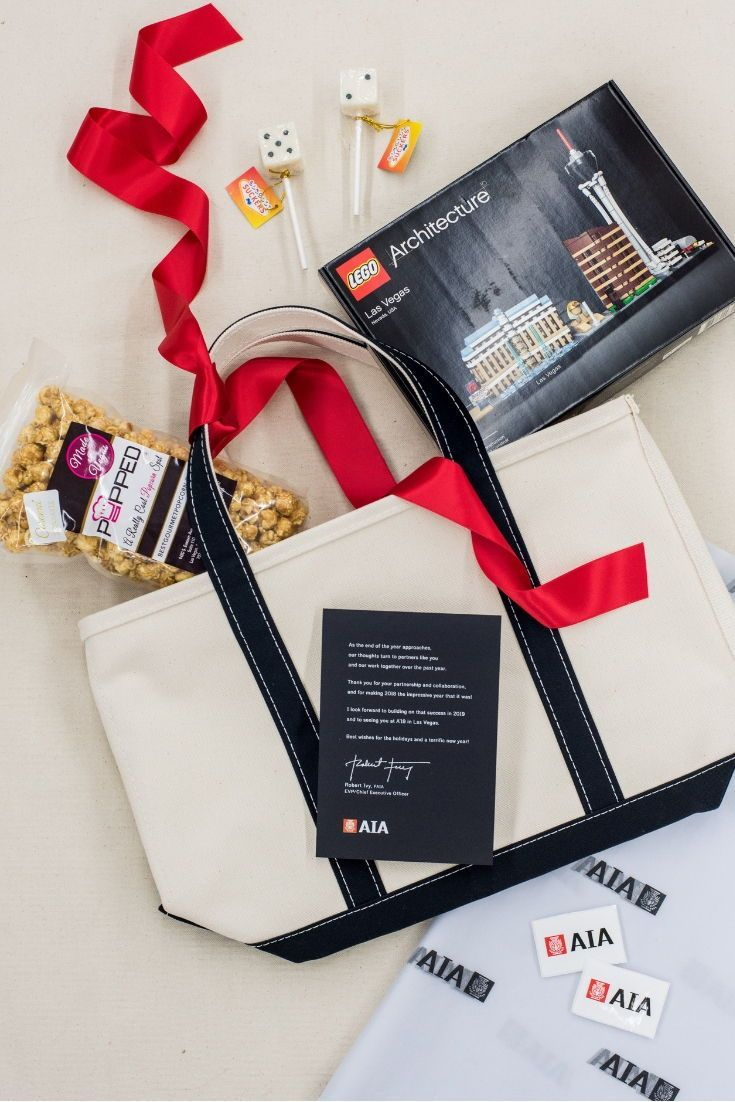 CORPORATE EVENT GIFTS// Red and cream corporate company event gift totes welcome...