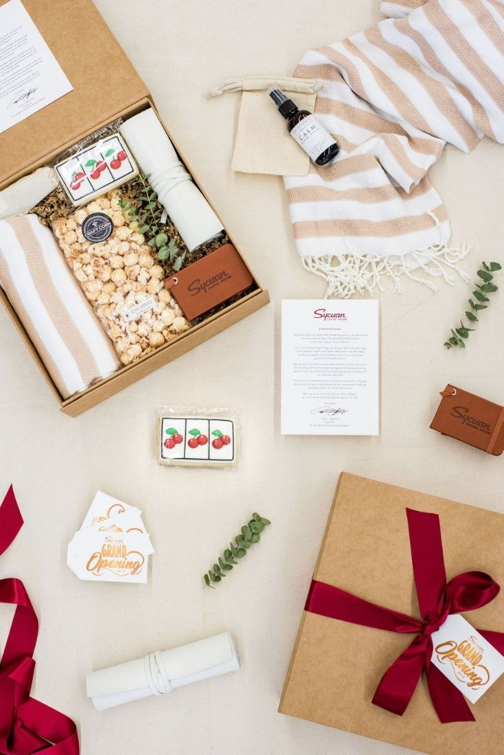 CORPORATE EVENT GIFTS// Beige and cherry red company gifts welcome casino guests...