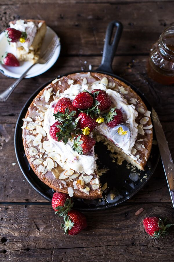 Topped with sliced almonds and strawberries, the subtle nutty flavor in this cak...