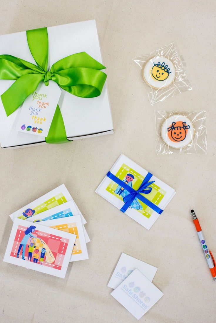CHARITY EVENT GIFTS// Colorful and bright gift boxes designed to welcome fundrai...