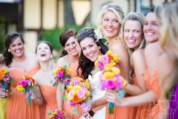 Love the colors of the bridesmaid dresses with the bouquets   www.theoverwhelme....