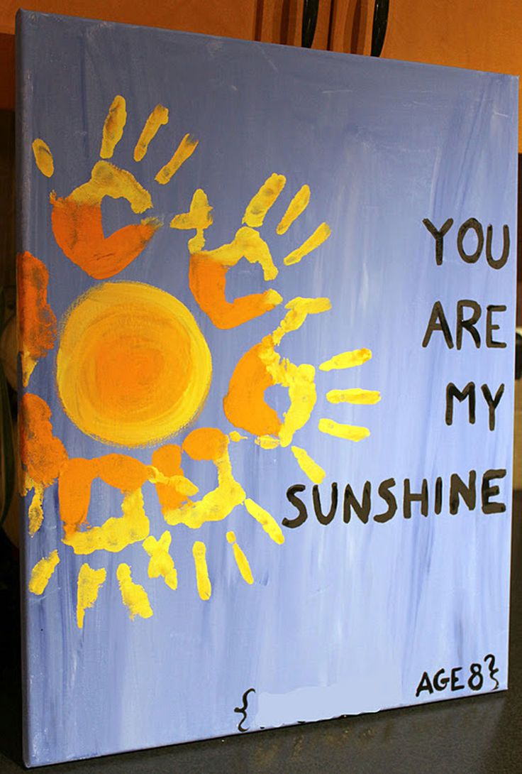 Create this adorable work of art by using your kids' handprints on a painted...