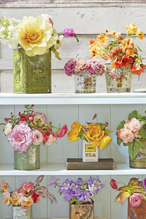 Give a nod to the Mother's Day tea party theme by turning antique tea tins into ...
