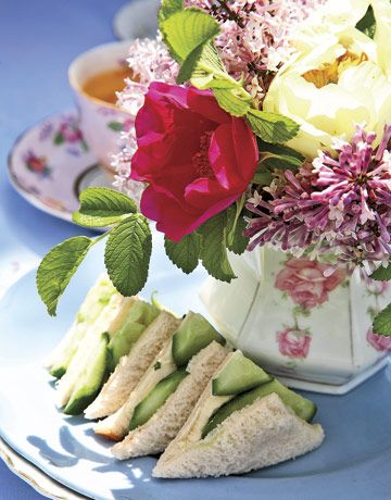 Served with tea—small sandwiches, mini cookies, and tiny tarts—sweeten the p...