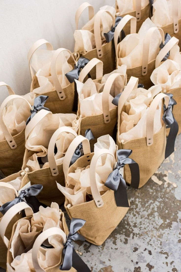 WEDDING WELCOME GIFTS// Cream and pewter canvas totes filled with local artisan ...