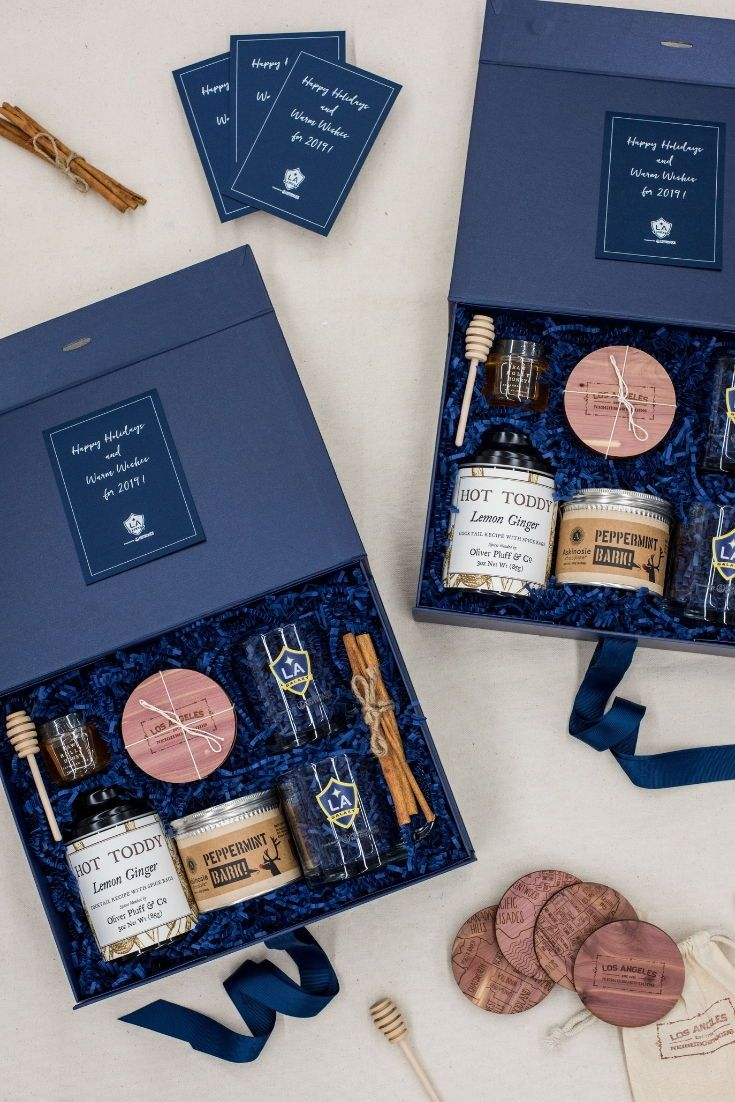 CLIENT GIFTS// Navy and kraft Los Angeles inspired client appreciation gift boxe...