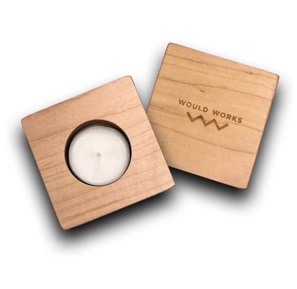 This simple handcrafted wood candle holder comes with a tea light and makes a me...