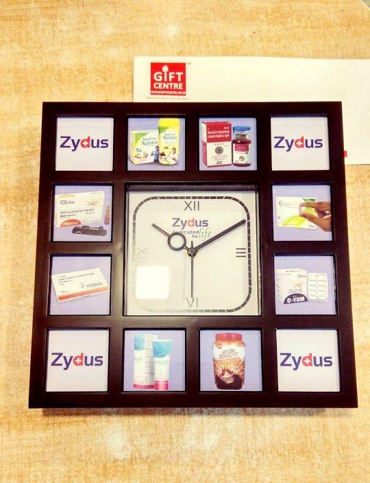 zydus wall clock with multi-pal products branding logo matrix