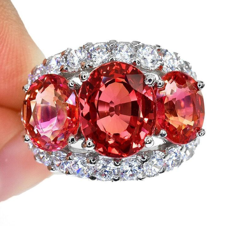A Vintage 12.5TCW Oval Cut Pink Padparadscha Sapphire Journey Halo Ring