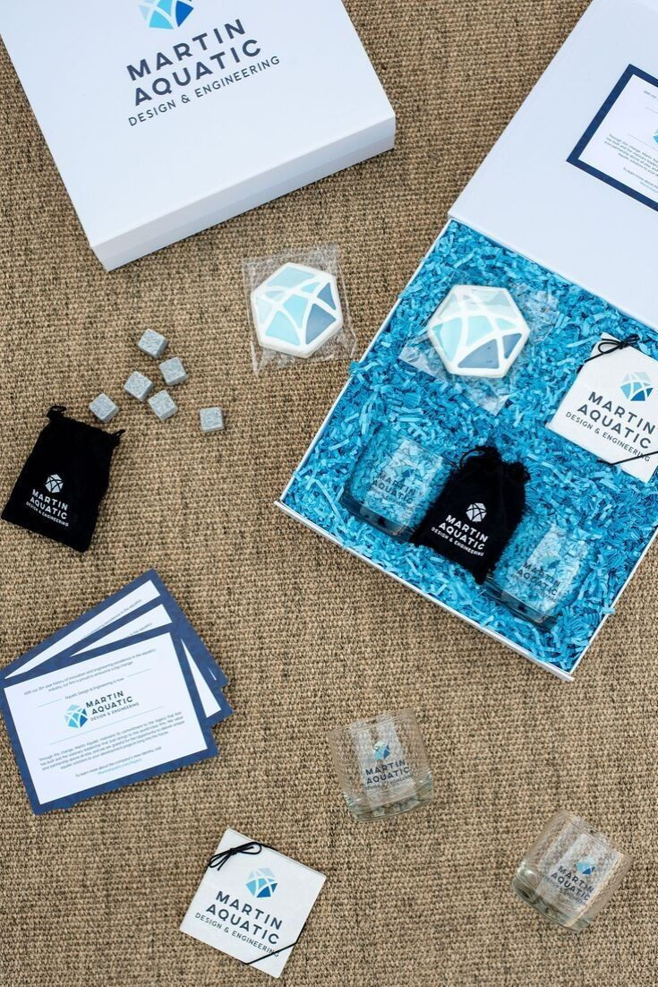 CORPORATE EVENT GIFTS// Blue and white on-brand gift boxes welcome business part...