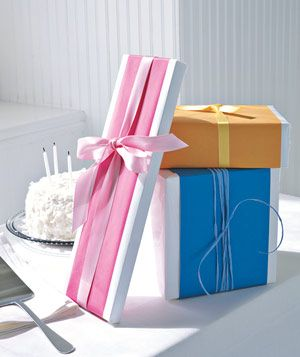 Boldly colored papers, contrasting with a white base layer. Colored ribbon to ma...
